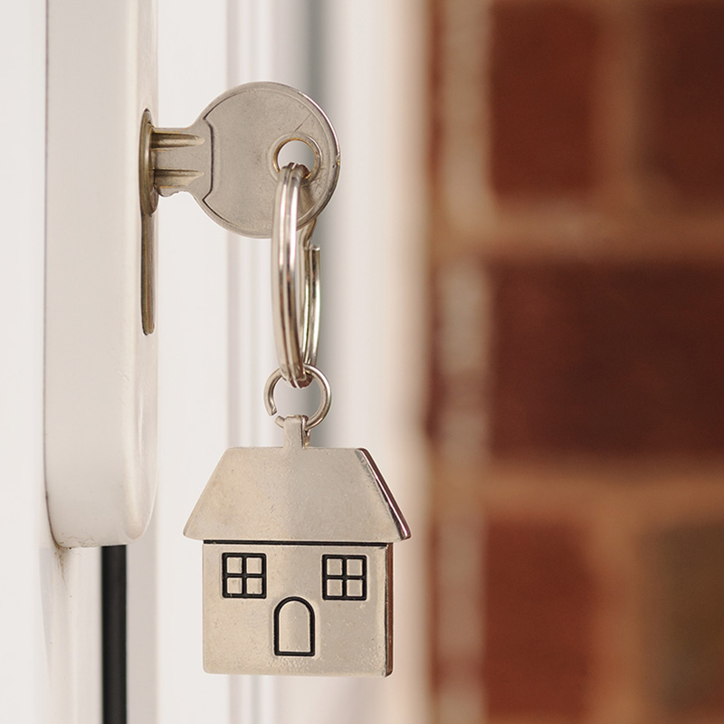 Key in holiday home door signifying access for inspections